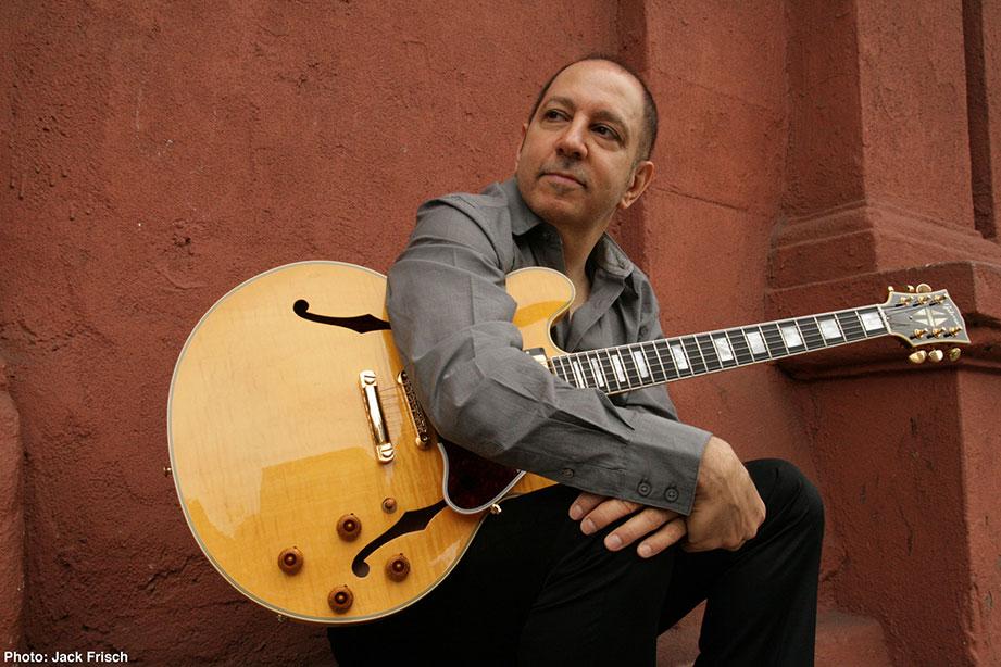 Greg Skaff holding guitar